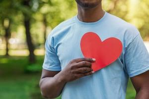 Guy holding Heart