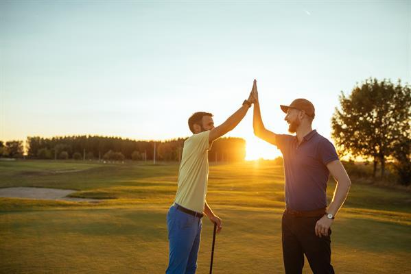 High-Five on Golf Field