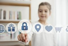 Little girl touching the security button on the digital screen - stock photo